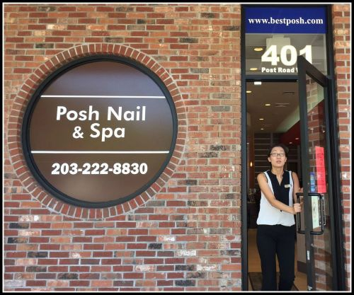 Posh Nail & Spa's doors were open Tuesday, despite the stop-work sign on the door. They're now legally open, they say.