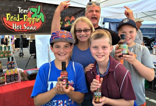These kids loved Mike's hot sauce.