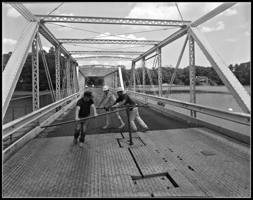 Hand-cranking open the Bridge Street (William Cribari) Bridge.
