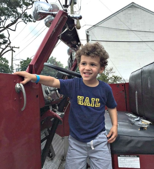 What kid doesn't like getting in a fire truck?