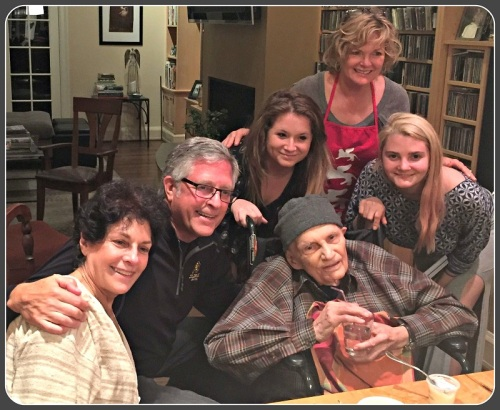 Gerry Gross with his daughter Sarah and son Adam (left), and other family members earlier this month, at his 94th birthday.