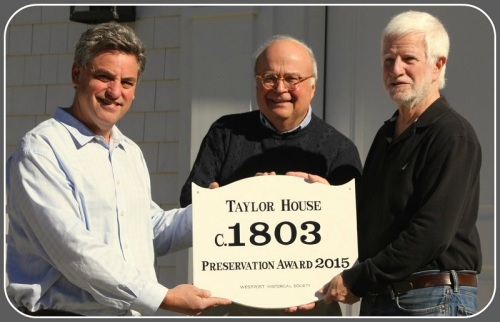 Presenting the 300th historical house plaque are (from left): builder Peter Greenberg, Westport Historical Society president Ed Gerber and WHS house historian Bob Weingarten. (Photo/Laurence Untermeyer)