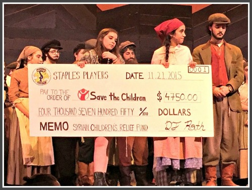 The symbolic check, presented to Save the Children after last night's performance.