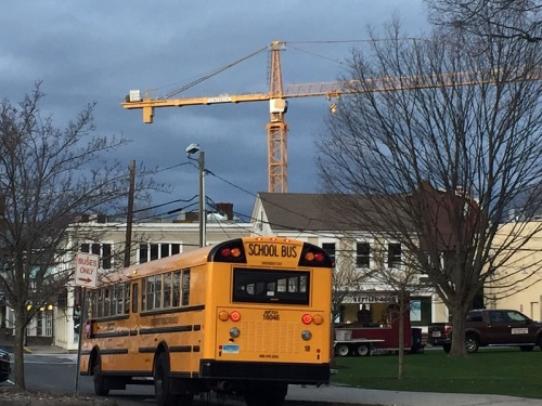 Buses provide transportation between downtown and Saugatuck Elementary School. Enjoy the crane -- it won't be there for First Night 2017.