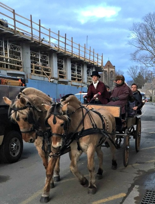 A mixture of old and new: horse-drawn carriage rides passes Bedford Square construction on Church Lane.