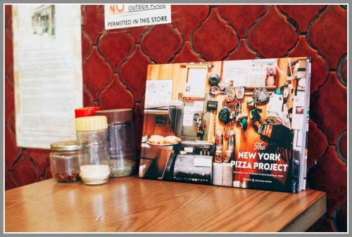 "You can buy ""The New York Pizza Project"" at many New York pizza joints."
