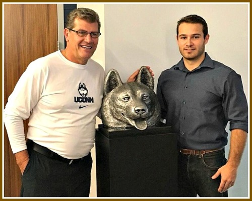 University of Connecticut women's basketball coach Geno Auriemma, with Jesse Nusbaum and his Husky sculpture.