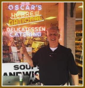 Oscar's owner Lee Papageorge gives thumb's-up to the Youth Commission's Student Discount Program.