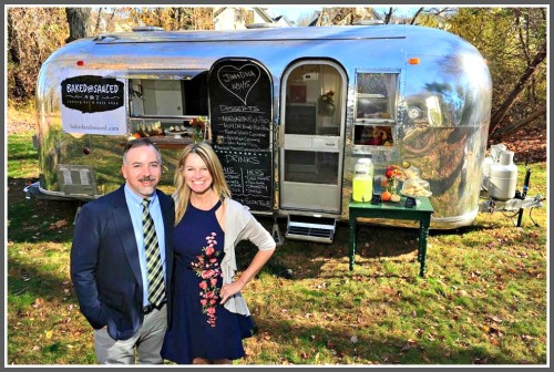 Mike and Kathy McGovern, with their converted Airstream trailer.