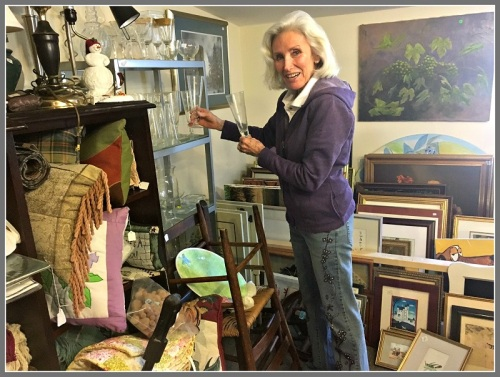 Curio Cottage director Karen Eickhoff, among a few of her many treasures.
