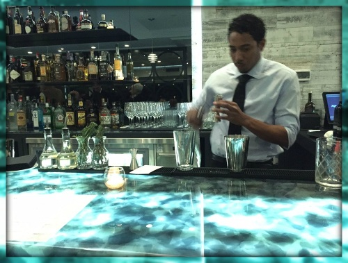 The stunning bar is made from recycled glass. Behind it is recycled wood.