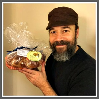 Tevye (Tony Award nominee Danny Burstein) enjoys challah from Connecticut.