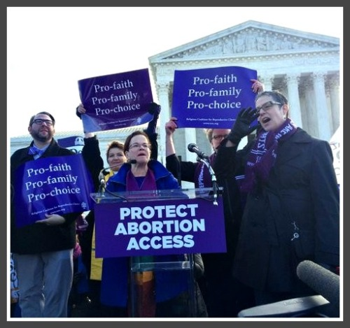 Rev. Debra Haffner (center) speaking on the steps of the Supreme Court yesterday.