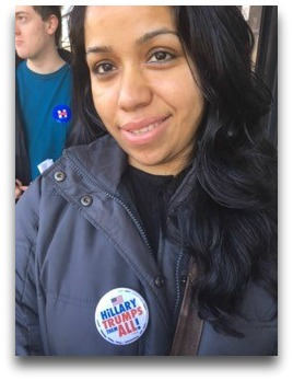 A Hillary supporter with her pin.