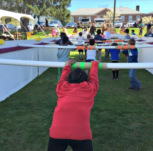 "Outside the main tent, a ""human foosball"" game was played. As in many real soccer games, the goalie is bored."