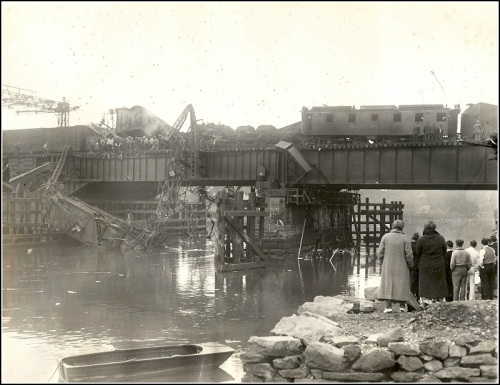 Westporters gather on the banks of the Saugatuck River, following the 1935 crash.