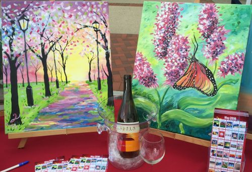 Painting with a Twist had a booth -- including (just like at their art sessions) a bottle of wine.