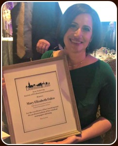 Mary Elizabeth Fulco, with her award.