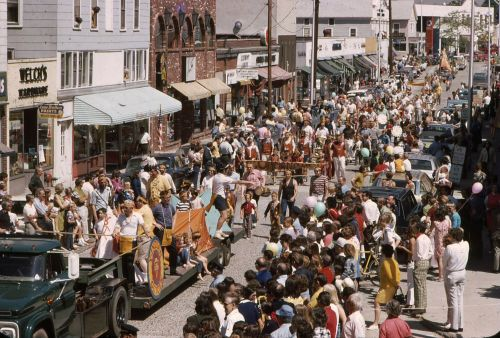 The Y Indian Guides make their way down Main Street (in 1971, a two-way road). Note spectators watching from 2nd-floor windows along the route.