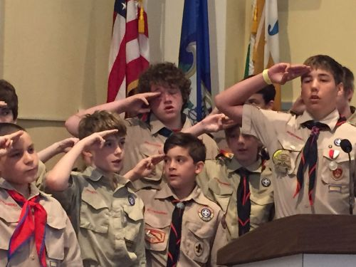 Troop 39 Boy Scouts lead the Pledge of Allegiance.