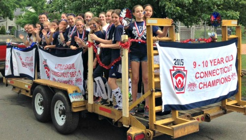 Westport's state champion 10-and-under softball team, and the 12-and-under runnersup, were all set to march (well, ride).