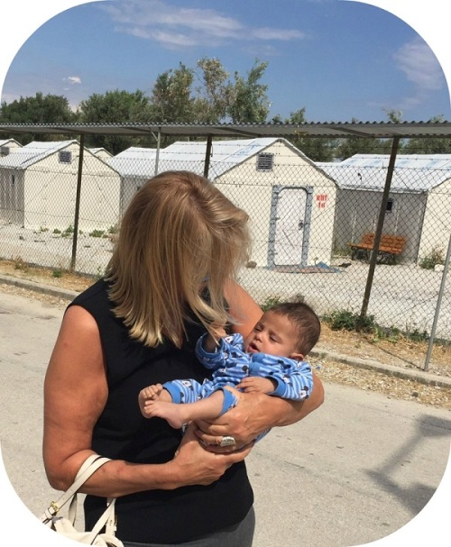 A pregnant mother survived the trip to Greece. Robin Tauck holds her 7-month-old -- who weighs only as much as a normal 2-month-old.