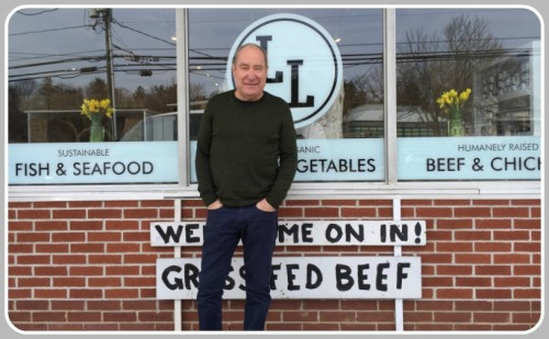 """Lloyd Allen, outside his current """"farm stand"""" on the Post Road."""