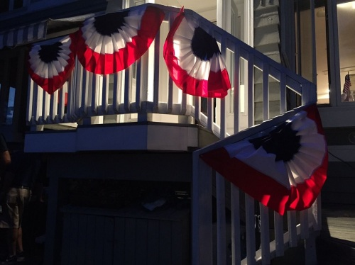 As night fell, bunting was illuminated on Soundview Drive.