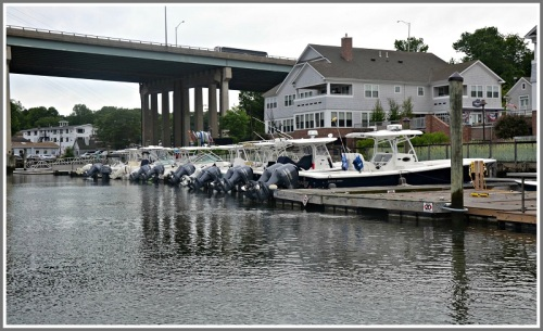 Boats moored on the Saugatuck River, south of the bridges. They can access the railroad bridge -- but not the Cribari swing bridge, Guimond says.
