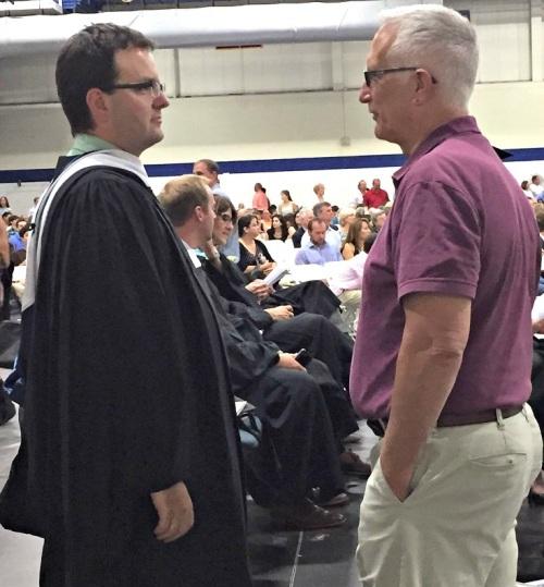 Former principal John Dodig (right) and incoming principal James D'Amico chat.