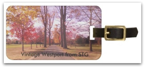 A luggage tag, with an image of the Longshore entrance.