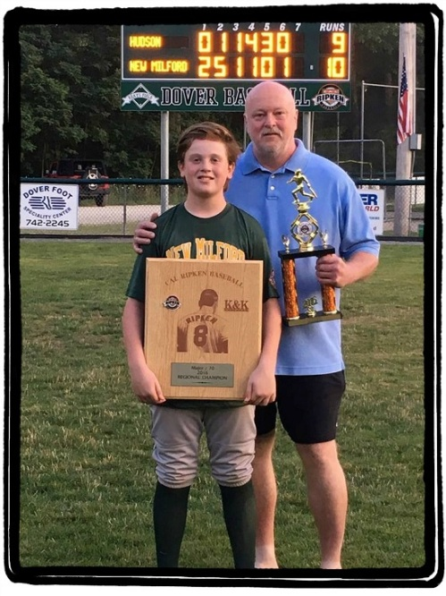 Rick Dickinson stands proudly with his son Cole.