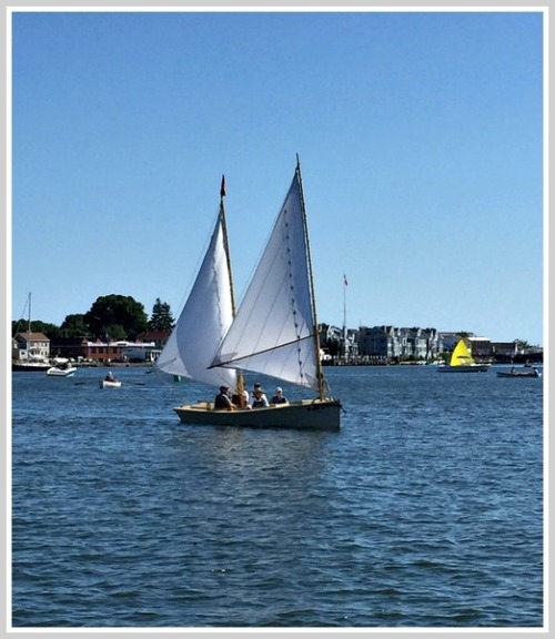 A double-masted Sharpie, on the Mystic River.
