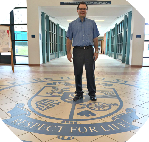 James D'Amico stands proudly in the foyer of Staples High School.