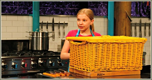 "Maizy Boosin waits to open her basket on ""Chopped."""