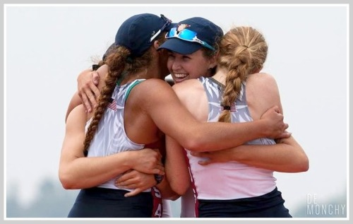 Kelsey McGinley (center) hugs her teammates after earning the women's junior 4+ bronze medal.