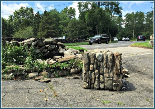 The stone wall after a recent accident. Drivers hit it when they fail to negotiate the southbound (toward McDonald's) curve.