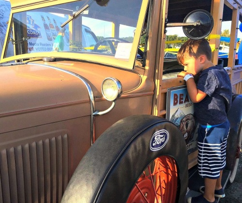 Nearby, a slightly older youngster explored the Beaver Beer car.