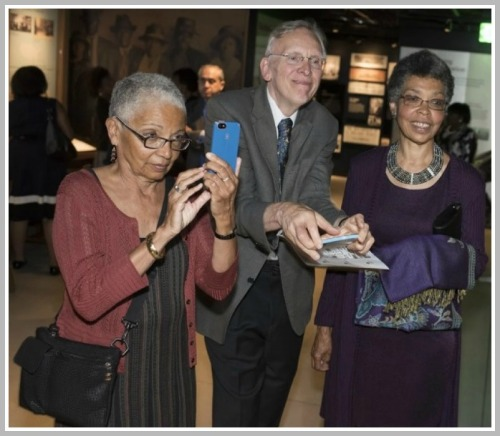 Judith Hamer (left), her sister Carolyn Thompson Brown, and brother-in-law Tim Eastman take photos at the National Museum of African American History and Culture preview. (Photo/Marvin Joseph for the Washington Post)