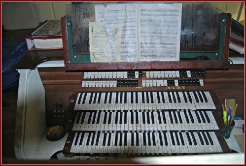 In 2011 the Saugatuck Congregational Church organ was covered with soot and water. But music still rested on its rack. (Saugatuck Church fire photos by Heather Hamilton)