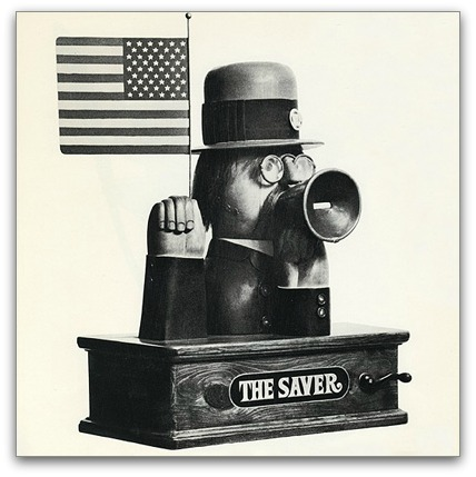 "Tjhe Einsels' ""Saver,"" made of copper, brass, polychrome and wood, 90 messages appear on tape in the megaphone as the flag is waved and the hat revolves."