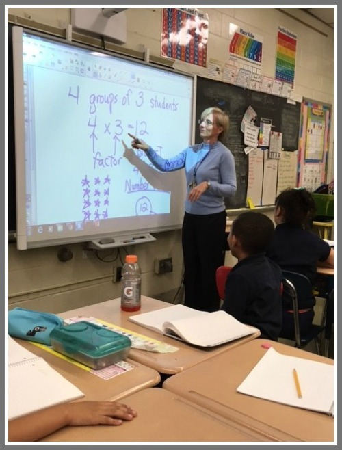 Kathy Mahieu in her classroom. She is lucky to have a whiteboard.