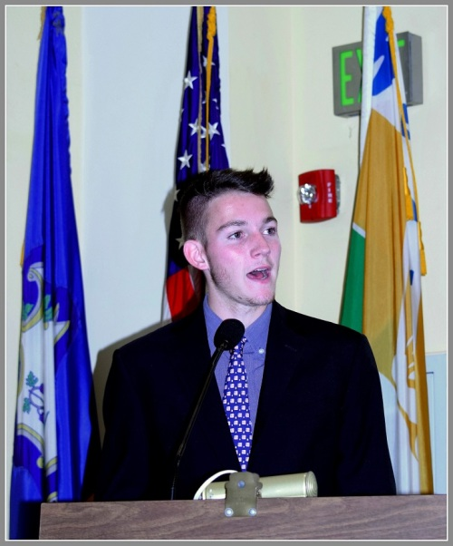 Spencer Daniels delivers Veterans Day remarks at Town Hall.