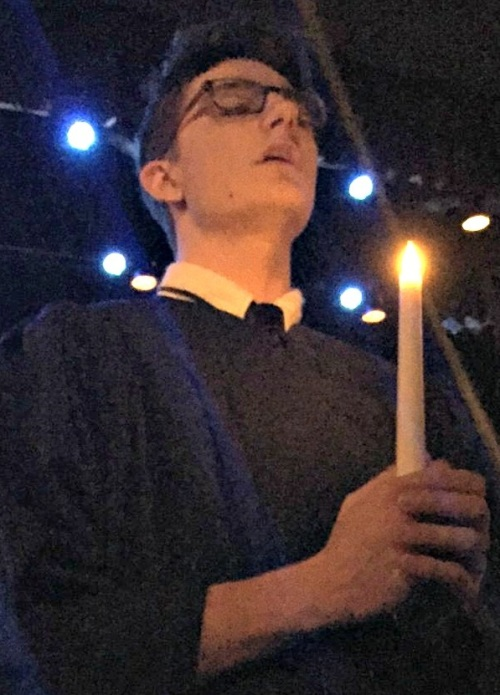 "Choir member Colin McKechnie, in the famous ""Sing We Noel"" processional."