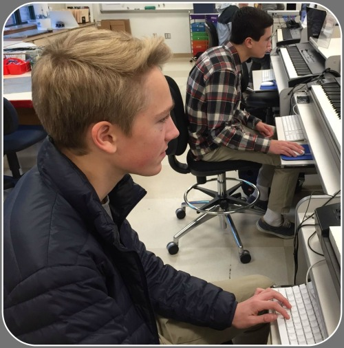 Gabe Holm (foreground) and Ben Matteson, hard at work in Carla Eichler's class.