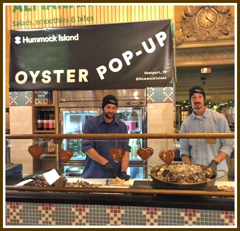 Pat Hanna and Kenny Varyruardrok of Hummock Island Shellfish opening oysters from Westport for the hungry masses.