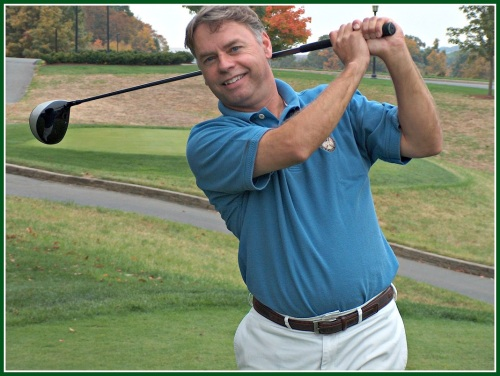 Fore! John Cooper in action.