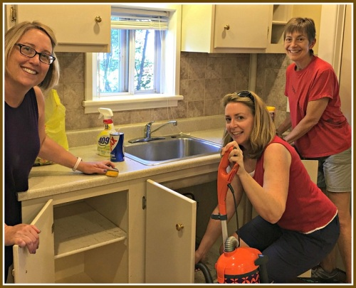 United Methodist Church volunteers Ellyn Gelman, Janis Liu and Brenda Maggio help prepare an apartment for the Syrian family's arrival. (Photo/Eva Toft)