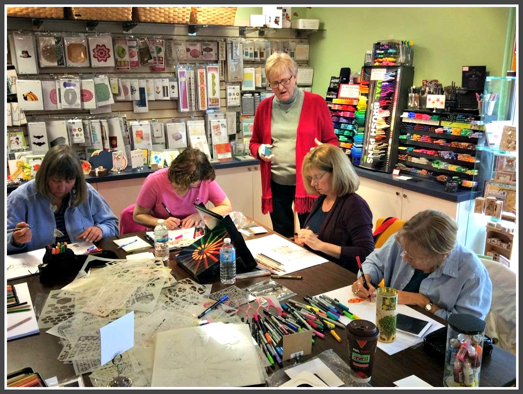 Judy Ritchie Standing With Customers Hard At Work During A Class