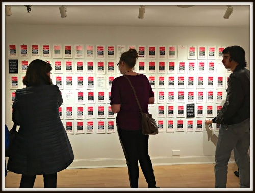 """Guests at last night's Westport Arts Center opening reception viewed dozens of """"I am more than ..."""" posters."""